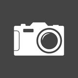Icono de la cámara en fondo negro Imágenes de archivo libres de regalías