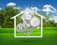 Icono de la casa con los engranajes Foto de archivo libre de regalías
