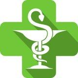 Icono de la farmacia en una cruz de la farmacia Imagenes de archivo