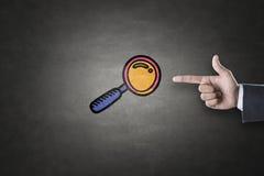 Icono de la lupa en la pizarra imagen de archivo libre de regalías