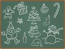 Icono de la Navidad en la pizarra Fotos de archivo libres de regalías