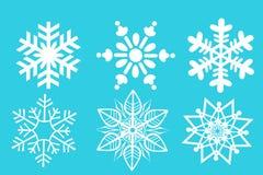 Icono de los copos de nieve en azul stock de ilustración