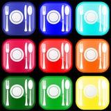 Icono de los platos y cubiertos en los botones Foto de archivo libre de regalías