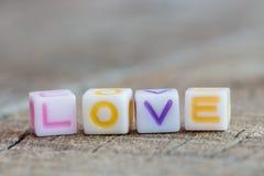 Icono del amor en la madera fotografía de archivo
