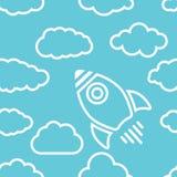 Icono del cohete blanco con las nubes en un fondo del aire azul - Foto de archivo libre de regalías