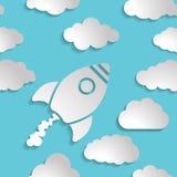 Icono del cohete blanco con las nubes en un fondo del aire azul - Foto de archivo