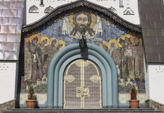 Icono del mosaico de Jesús en la fachada en iglesia Fotografía de archivo