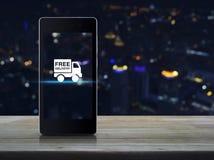 Icono libre del camión de reparto en la pantalla elegante del teléfono imagenes de archivo