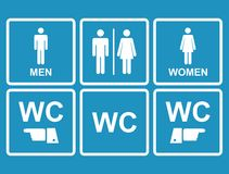 Icono masculino y femenino del WC que denota el retrete, lavabo Imagen de archivo libre de regalías