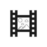 Icono negro de la película con las montañas Imagen de archivo