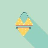 Icono plano del traje de natación con la sombra larga Fotografía de archivo