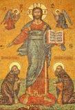 Icono por la entrada de las iglesias Foto de archivo
