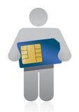 Icono que sostiene una tarjeta del sim Foto de archivo libre de regalías