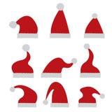 Icono rojo del sombrero de Papá Noel en blanco Fotos de archivo