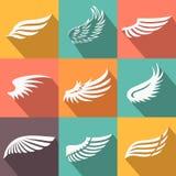 Iconos abstractos de las alas del ángel o del pájaro de la pluma fijados Foto de archivo