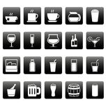 Iconos blancos de la bebida en casillas negras Foto de archivo