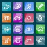 Iconos blancos de la medicina en los botones del color. Imagenes de archivo
