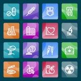 Iconos blancos de la medicina en los botones del color. Foto de archivo