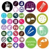 Iconos blancos del hospital y círculo colorido Imagenes de archivo
