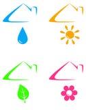 Iconos coloridos debajo del tejado de la casa Imagen de archivo libre de regalías