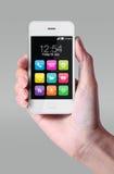 Iconos coloridos del app que muestran en smartphone Imágenes de archivo libres de regalías