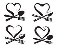 Iconos con la cuchara, la bifurcación y el corazón Imagen de archivo libre de regalías