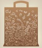 Iconos de la comida en bolsa de papel Fotografía de archivo libre de regalías