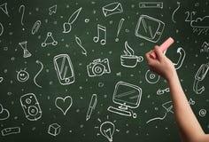 Iconos de la escritura de la mano en la pizarra Fotos de archivo libres de regalías