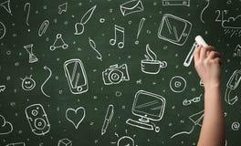 Iconos de la escritura de la mano en la pizarra Imagen de archivo libre de regalías