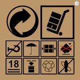 Iconos de la manipulación de carga usados al lado de las cajas y del empaquetado Imágenes de archivo libres de regalías