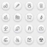 Iconos de la medicina con los botones blancos en backgrou gris Fotografía de archivo libre de regalías