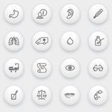 Iconos de la medicina con los botones blancos en backgrou gris Foto de archivo