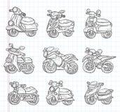Iconos de la motocicleta del garabato Foto de archivo libre de regalías