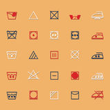 Iconos de la muestra y del símbolo del cuidado de la tela con la sombra Fotografía de archivo
