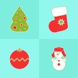 Iconos de la Navidad en un fondo azul Fotografía de archivo libre de regalías