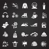 Iconos de la Navidad fijados en fondo negro stock de ilustración