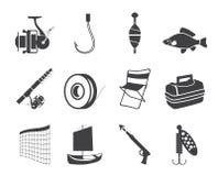 Iconos de la pesca y del día de fiesta de la silueta Foto de archivo
