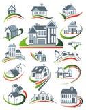 Iconos de las casas fijados. Propiedades inmobiliarias. Fotografía de archivo