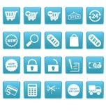 Iconos de las compras en cuadrados azules Imagenes de archivo