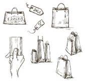 Iconos de las compras, etiqueta de la venta, bolsas de papel, mano con cr Imágenes de archivo libres de regalías