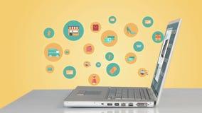 Iconos de las compras surgiendo por el ordenador portátil almacen de metraje de vídeo