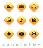 Iconos de las multimedias en los botones amarillos del Rhombus Fotos de archivo