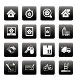 Iconos de las propiedades inmobiliarias en casillas negras Fotos de archivo libres de regalías