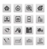 Iconos de las propiedades inmobiliarias en casillas negras Imagenes de archivo