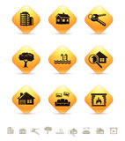 Iconos de las propiedades inmobiliarias en los botones amarillos Imágenes de archivo libres de regalías
