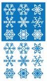 Iconos de los copos de nieve en el fondo blanco y azul Fotos de archivo libres de regalías