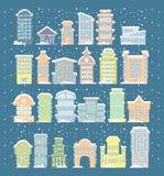 Iconos de los edificios del invierno Rascacielos y torres en nevadas nieve Foto de archivo libre de regalías