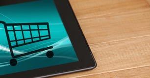 Iconos del carro de la compra en la tableta digital Fotografía de archivo libre de regalías