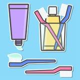 Iconos del cepillo de dientes y de la crema dental Fotos de archivo