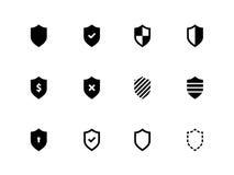 Iconos del escudo en el fondo blanco. Foto de archivo libre de regalías
